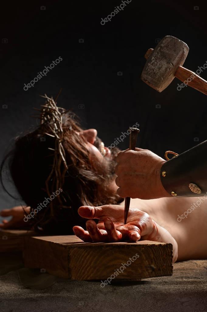 Jesus Being Nailed to the Cross — Stock Photo © ginosphotos1 #129082768