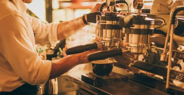 barista make coffee latte art with coffee espresso machine in co