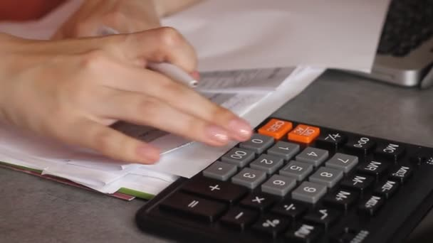 Close up of female accountant or banker making calculations. Home finances, investment, economy, saving money or insurance concept. Hands closeup.