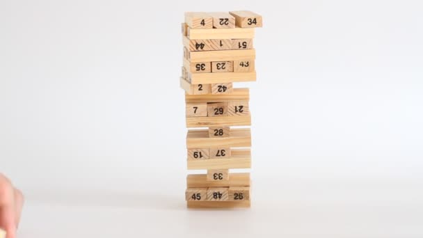 Woman and man plays jenga on white background. Family recreation and holidays concept.