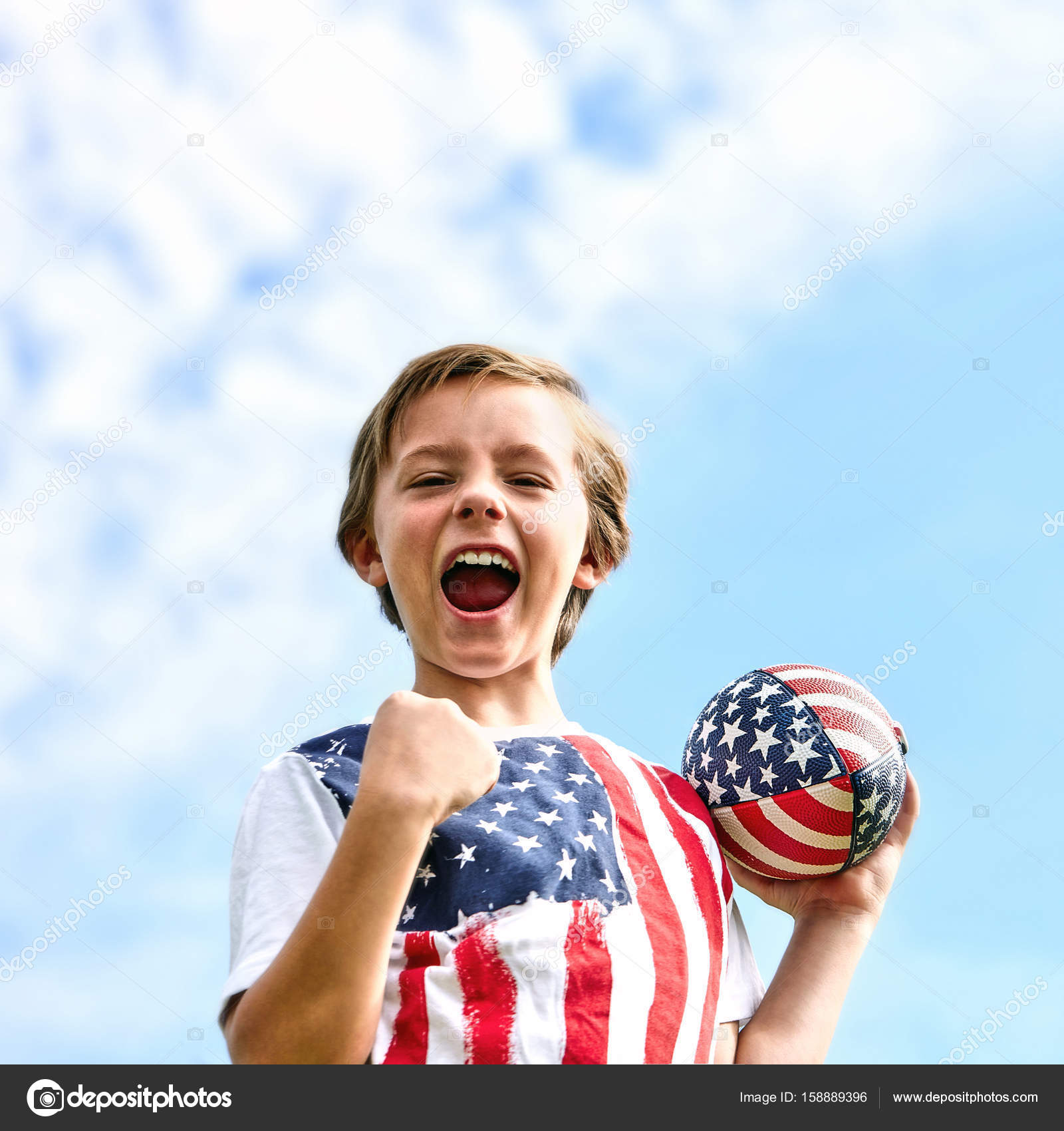 excited little boy screaming holding rugby ball stock photo