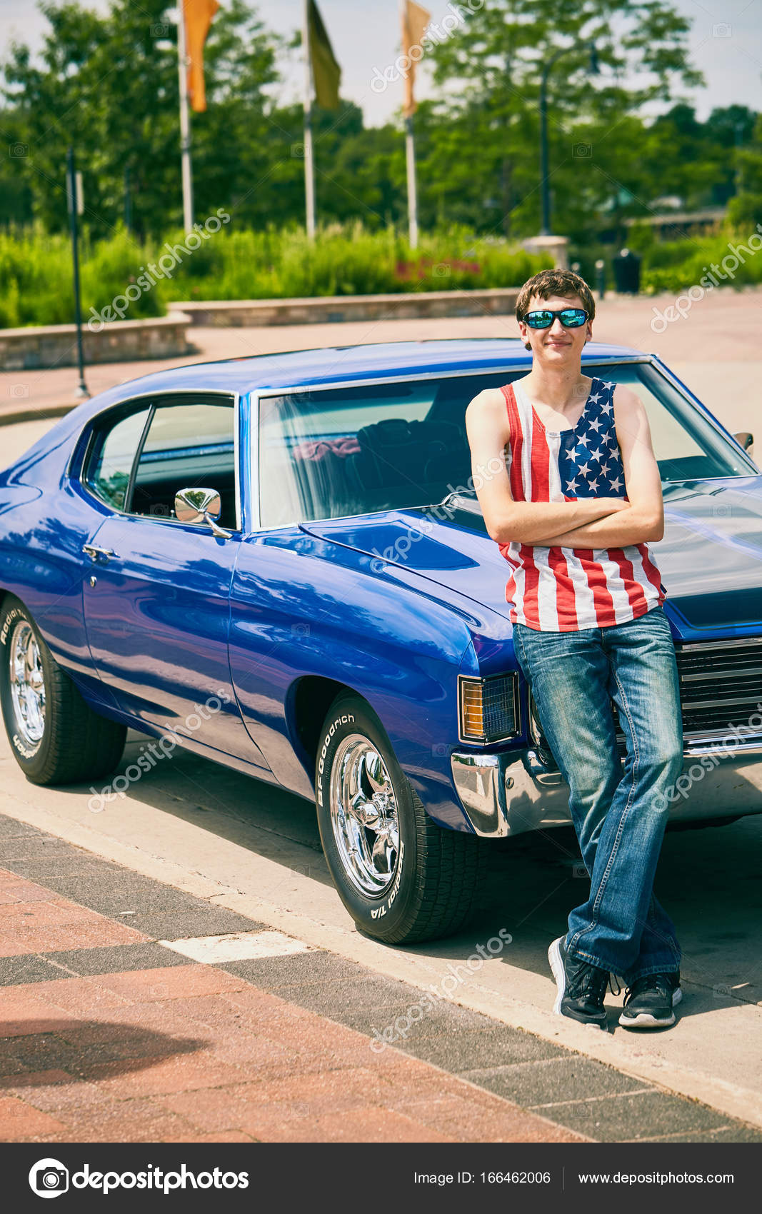Portrait Of Cool Young Caucasian Man Wearing American Tank Top And  Sunglasses Standing At His New Blue Car With Crossed Arms And Smiling U2014  Photo By ...