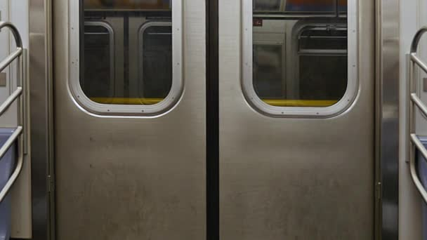 An ... & Interior Shot of Closed New York City Subway Doors as Car Approaches ...