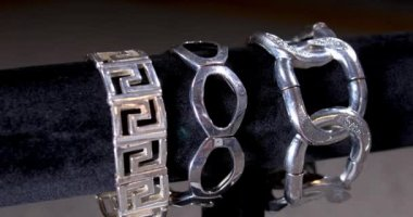 Rotating Display of Silver Costume Jewelry Merchandise