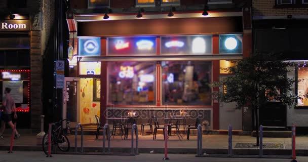 Night Establishing Shot of Typical Bar Restaurant in City
