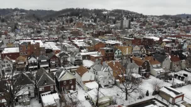 Slow Forward Aerial Establishing Shot of Small Village in Winter
