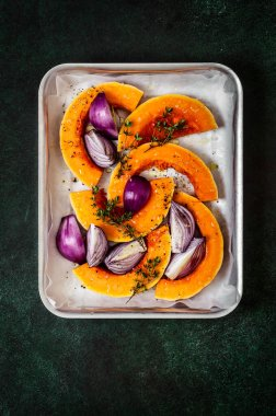 Butternut Squash Slices with Red Onions and Thyme Prepared for Roasting, copy space for your text