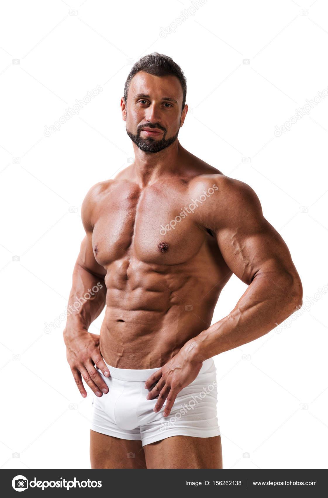 865e61d627 Atletic musculoso hombre en ropa interior aislada en un blanco - poses de modelos  hombres en traje de baño — Foto de ...