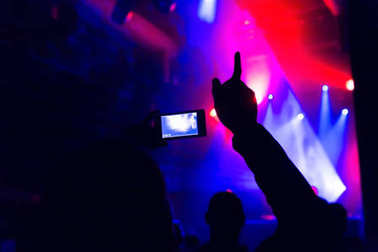 Man taking photo video mobile phone crowd party