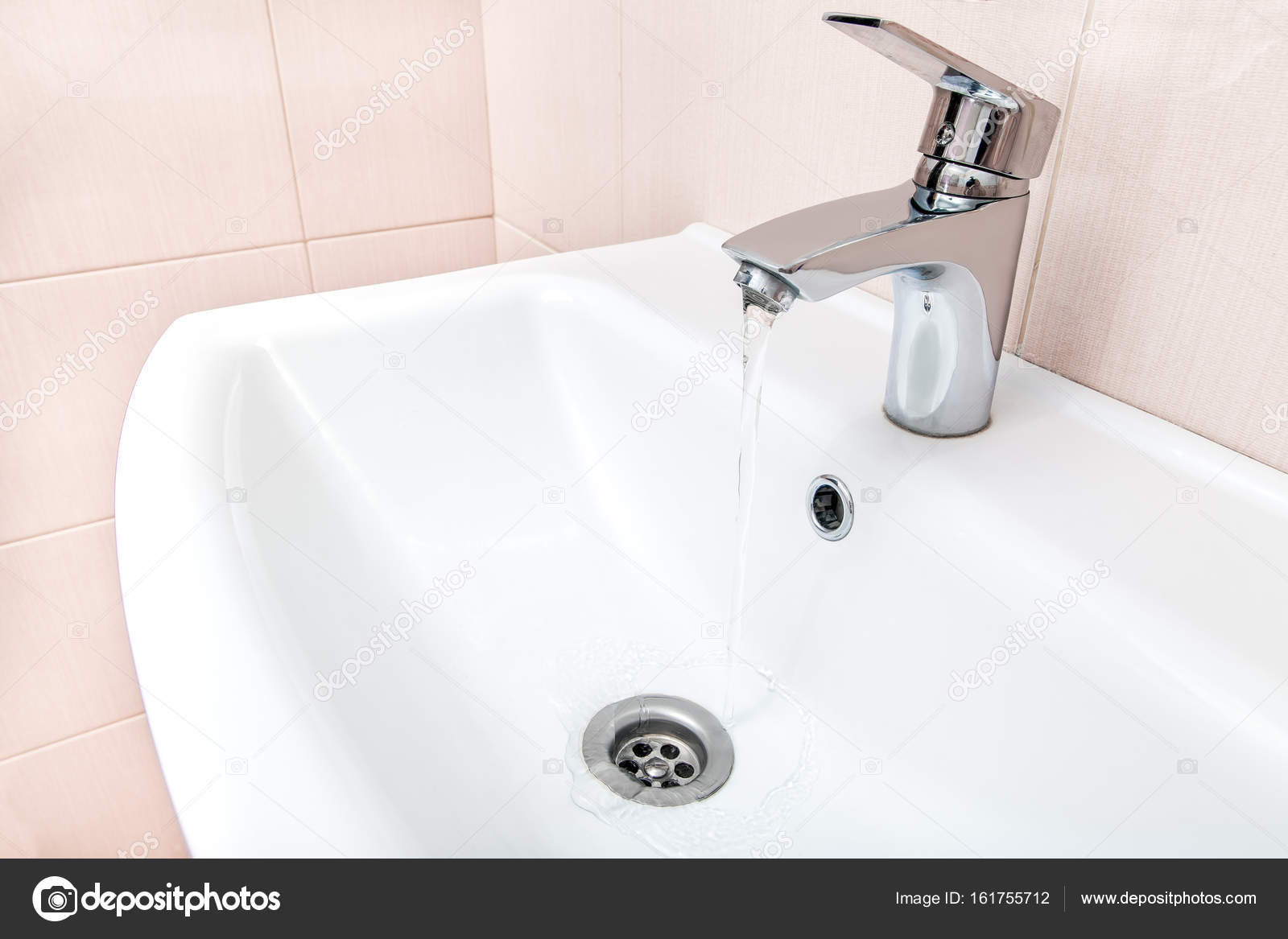 open chrome faucet water flow in the wash basin. — Stock Photo ...