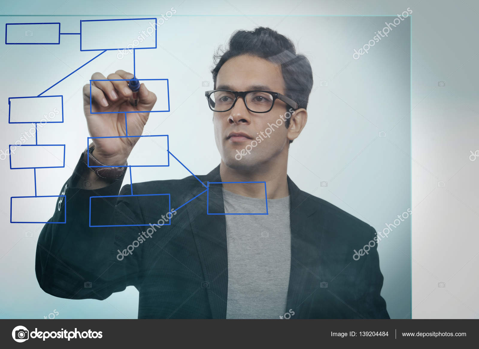 Businessman drawing an empty flowchart stock photo iphemant businessman drawing an empty flowchart on glass photo by iphemant nvjuhfo Gallery