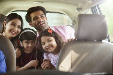 family  looking out of car window