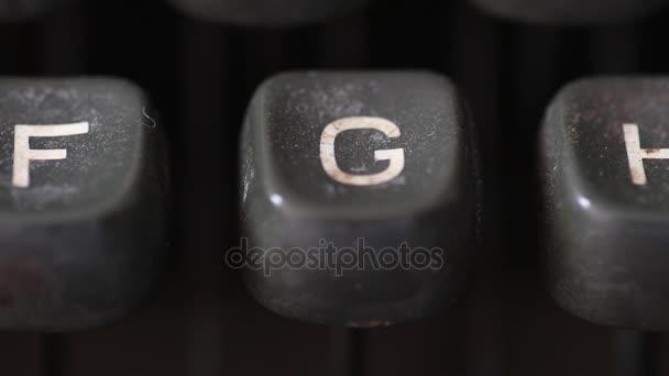 Typing the letter G key on old vintage typewriter