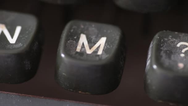 Typing the letter M key on old vintage typewriter