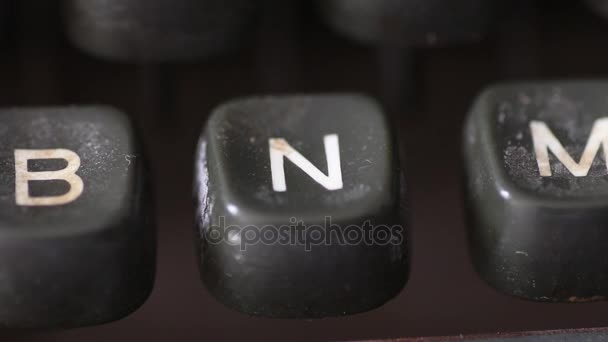 Typing the letter N key on old vintage typewriter