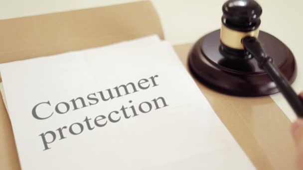 Shot of Consumer protection written on legal documents with gavel