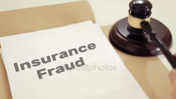 Insurance Fraud written on legal documents with gavel