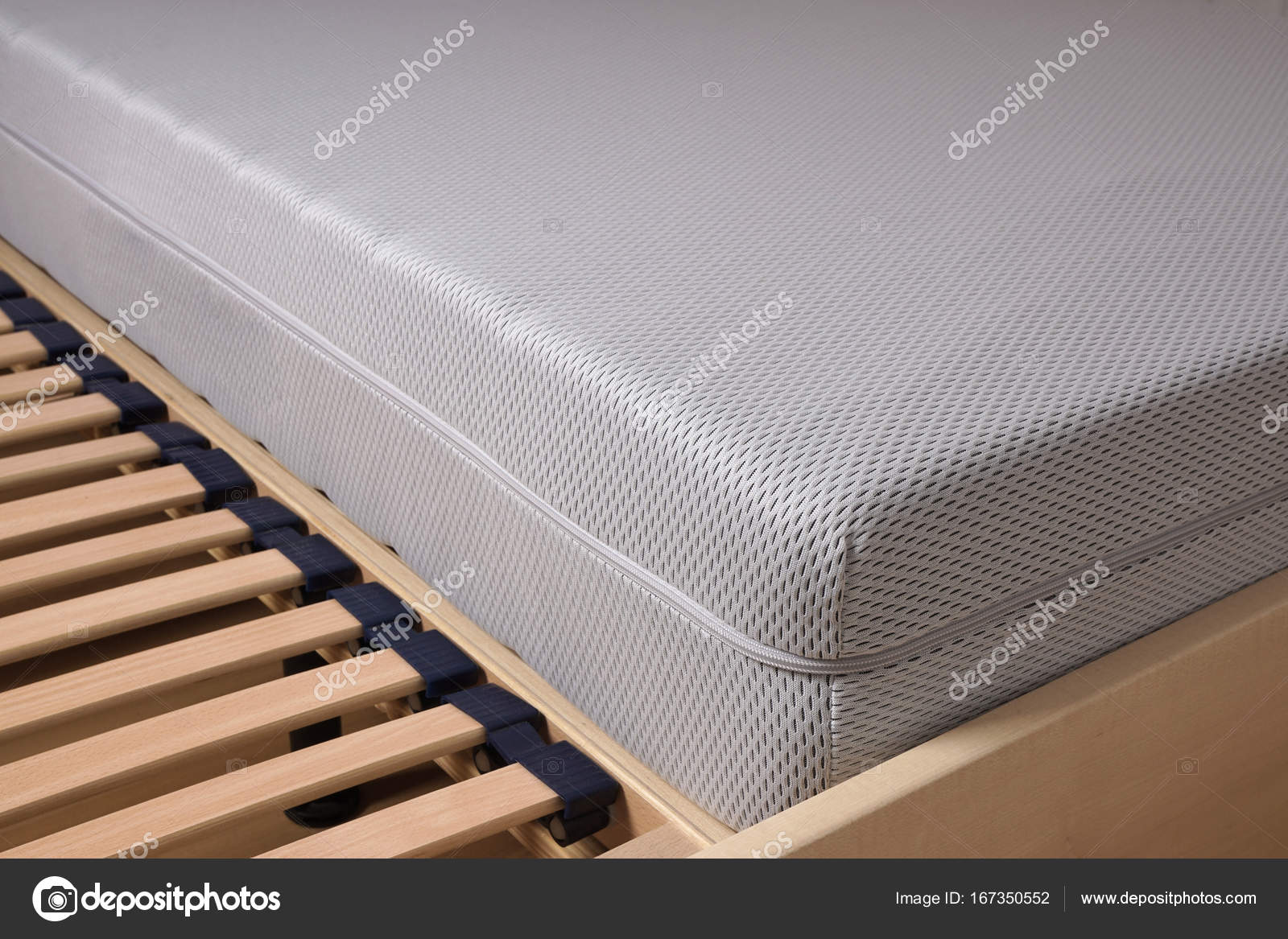 cold foam mattress on slatted frame — Stock Photo © buecax #167350552