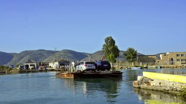 Saranda, Albania - August 2014: ferry boat moving across river with cars