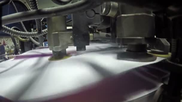 4K Pages being fed into a two color offset printing press. All the photographic images in this clip are property released. UHD stock video