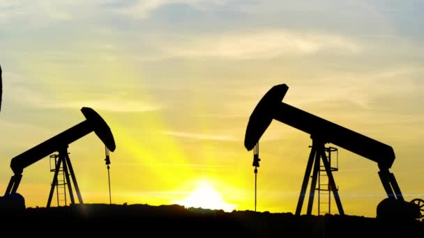 Oil well piston pumps at sunset, Pumping Jack - HD Stock Video