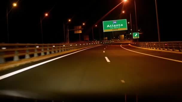 Driving on Highway at night with exit sign of Atlanta city, Giorgia