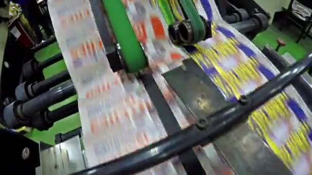 Close up of magazine printing on production line at factory
