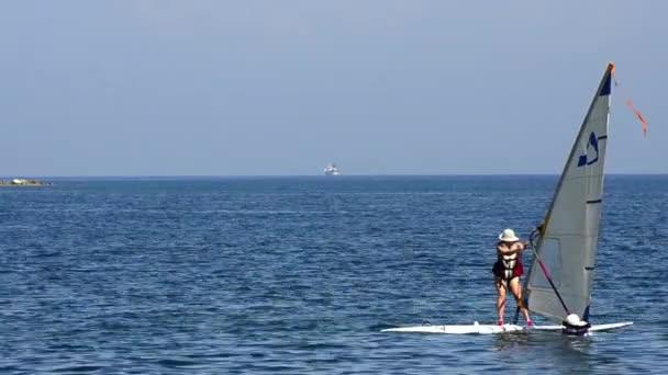Windsurfer riding the waves into laguna blue sea waters