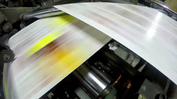 Newspapers on print line in factory, printing mechanism rolling freshly typed papers