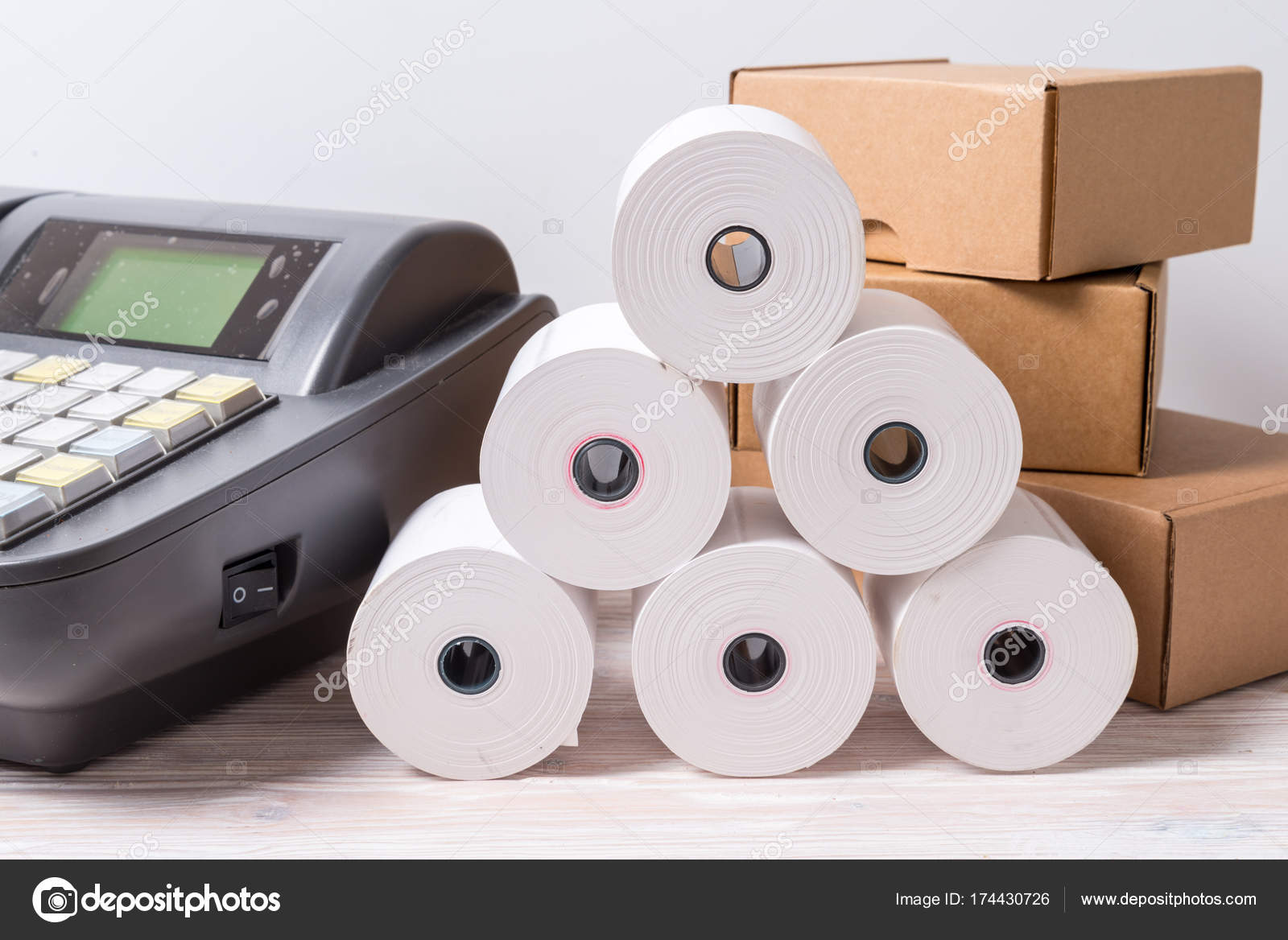Electronic Cash Register and lot of paper roll — Stock Photo