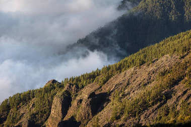 Sea of clouds in volcanic landscape of Teide national park, Tenerife, Canary islands, Spain.