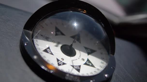 Close up and slow motion of compass in black case on ship, large marine compass