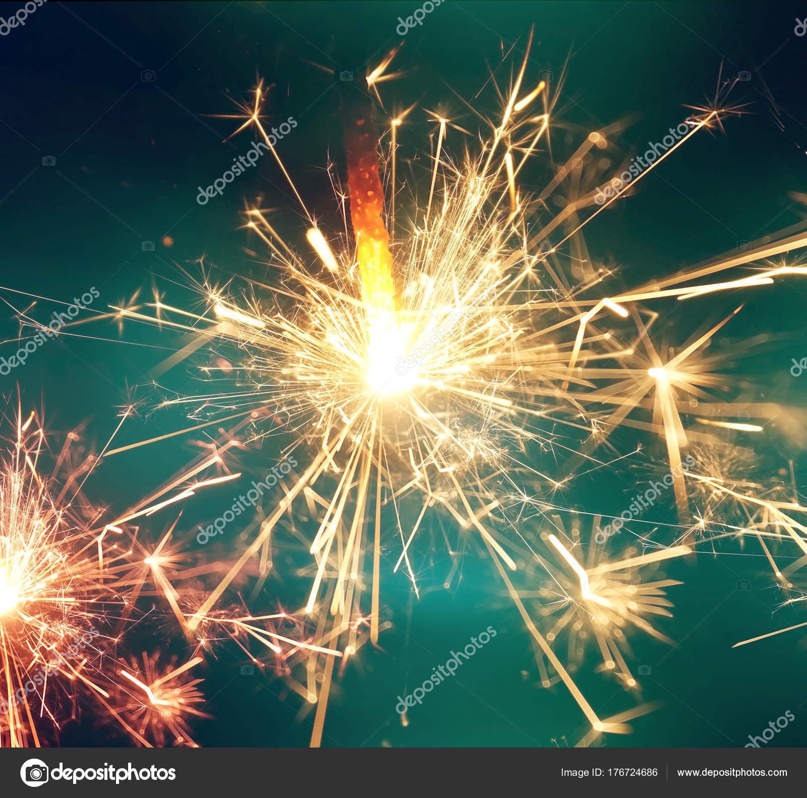 sparkler fire new year celebration background stock photo
