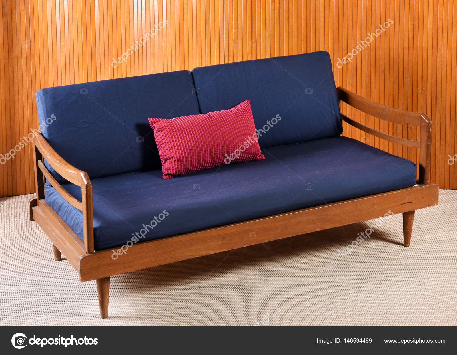 Retro Sofa With Navy Blue Cushions In Living Room Stock