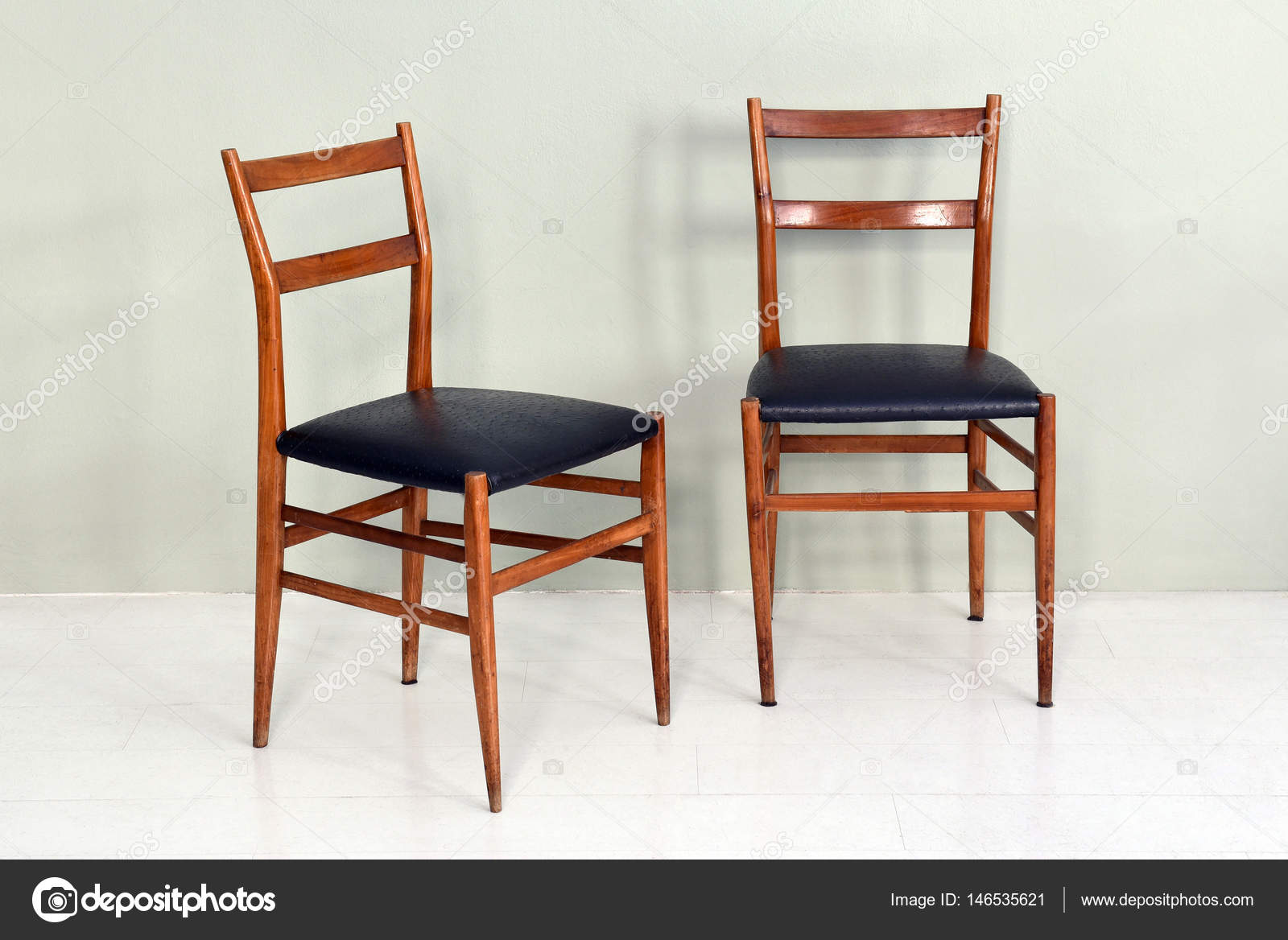Old Fashioned Kitchen Chairs Pair Of Retro Kitchen Chairs With Wood Legs Stock Photo C Photology1971 146535621