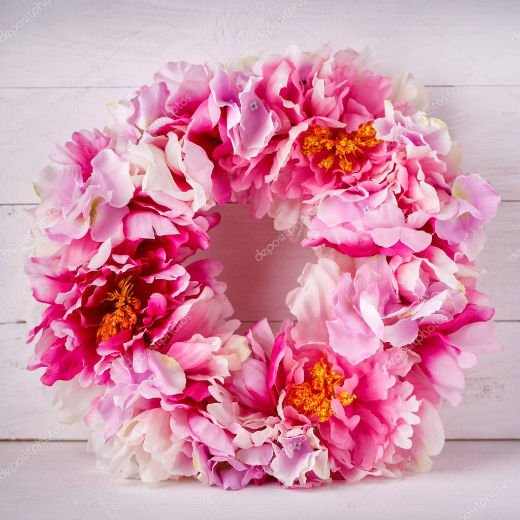 Flower decorative wreath for decorating the interior. Designer decoration for a door or a home.