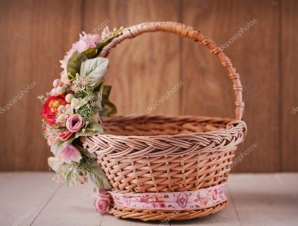 The basket is decorated with flowers. Decoration for the interior.