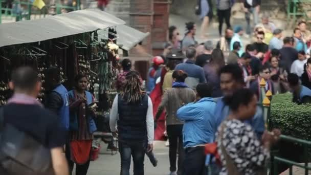Kathmandu, Nepal - 14 November 2019: A nepalese, Indian traditional market. People walking, passing by a local market. City Kathmandu, Nepal. People selling handicrafts.