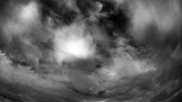 Time lapse clouds on black and white sky