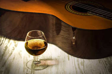 Concept behind the music the guitar, the glass of cognac