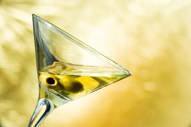 A martini glass with olives