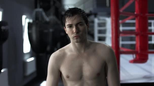 Portrait handsome man boxer after training sweat
