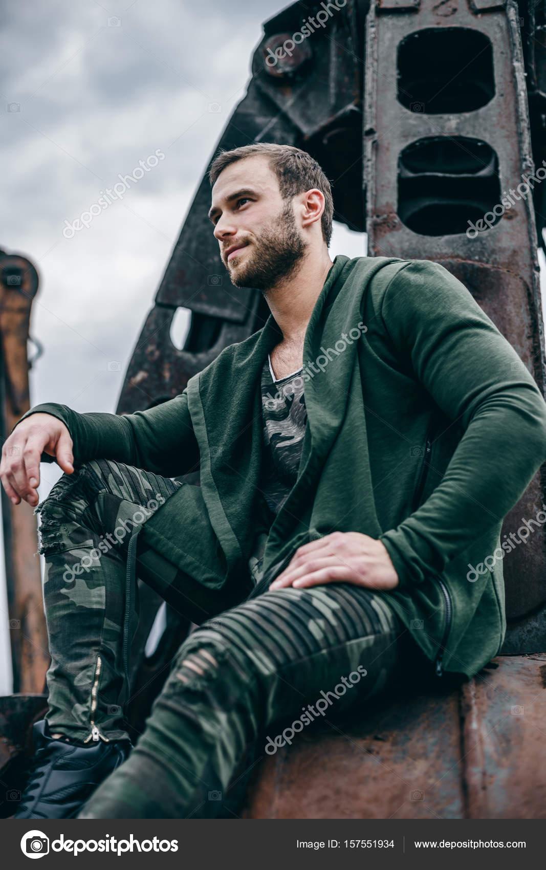 Portrait fashion man wearing clothes khaki colors in urban
