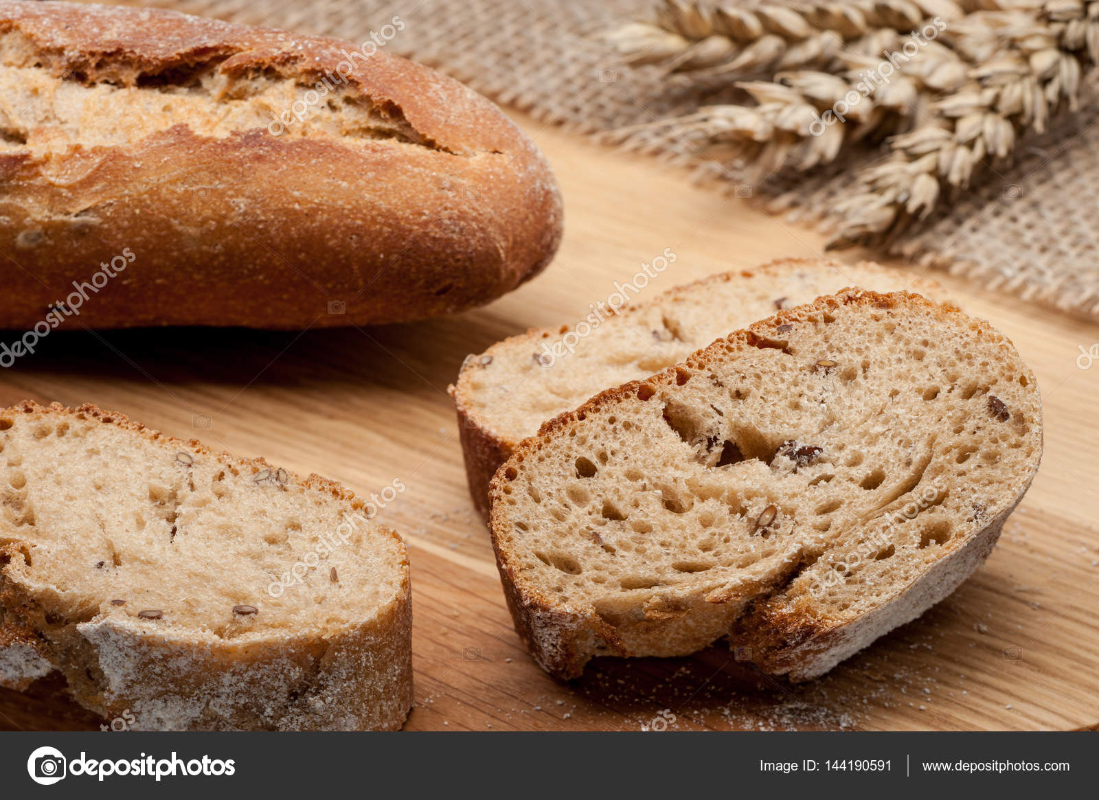 Sliced Baguette Bread On Wooden Table Stock Photo