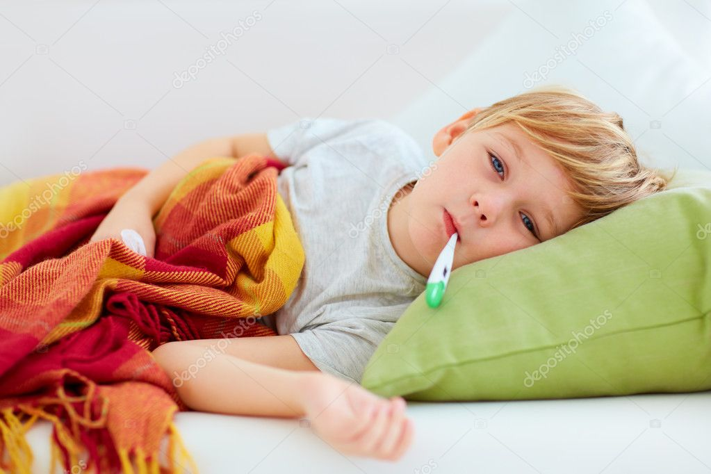 Sick kid with runny nose and fever heat lying on couch at home sick kid with runny nose and fever heat lying on couch at home stock photo altavistaventures Gallery
