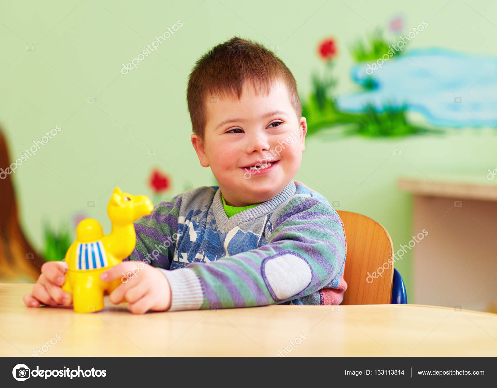 cute kid with down's syndrome playing in kindergarten — stock photo