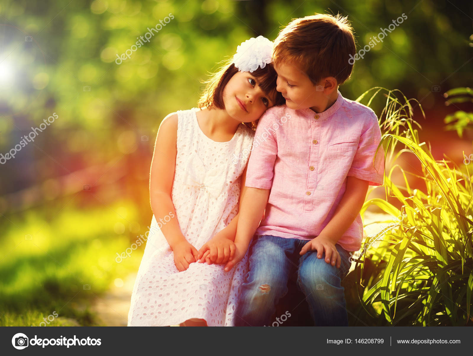 cute kids in love, sitting together in spring garden — stock photo