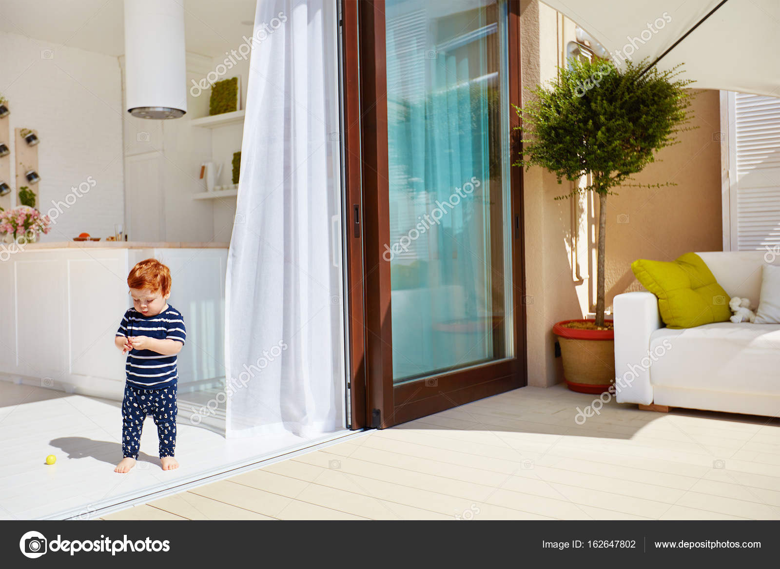 A toddler baby walking on open space kitchen with roof top patio and sliding doors u2014 Photo by olesiabilkei & a toddler baby walking on open space kitchen with roof top patio and ...