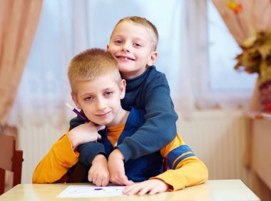 two cute kids, friends in rehabilitation school for kids with special needs