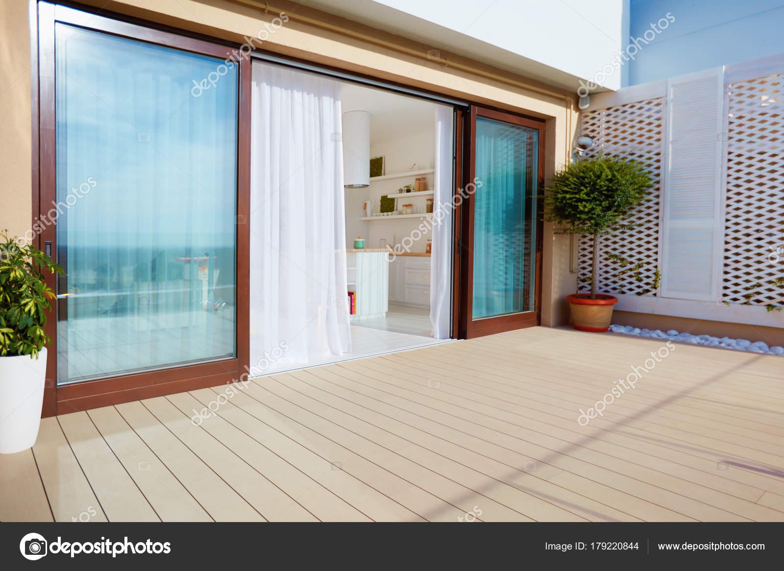 Roof top patio with open space kitchen sliding doors and decking on upper floor u2014 & roof top patio with open space kitchen sliding doors and decking on ...
